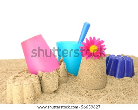 Colorful child's beach toys on a white background