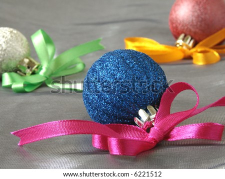 colorful christmas baubles with bows