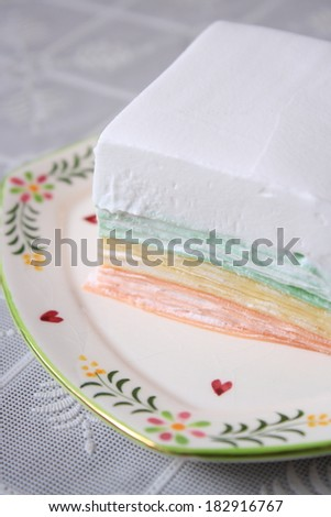 colorful crape cake with big layer of cream