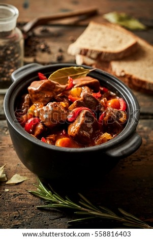 Colorful Crock Of Hungarian Beef Goulash Seasoned With Paprika Bay Leaves And Sweet Peppers On