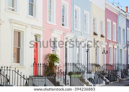 Colorful English houses facades, pastel pale colors in London