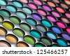Colorful eye shadows palette. Makeup background. Colorful make-up palette - stock photo