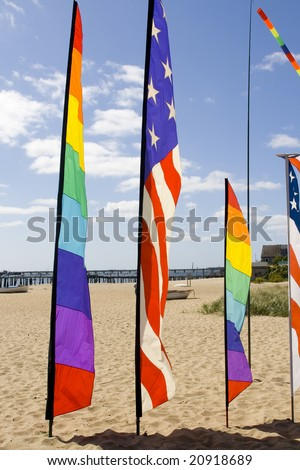 colorful flags standing on a sunny beach