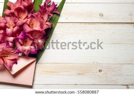 Colorful flowers in envelope, flower delivery concept. congratulate