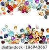 Colorful gems on white background. Many real polished stones: amethyst, sapphire, blue topaz, rainbow moonstone, labradorite, ruby, chalcedony, lapis lazuli, aventurine, peridot, rose quartz, citrine. - stock photo