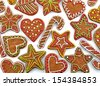 Colorful gingerbread cookies on white background - stock photo