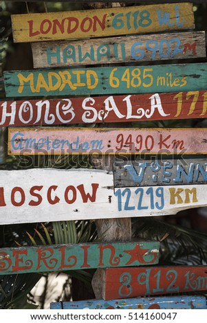 Colorful hand painted distance signs in Koh Phangan, Thailand