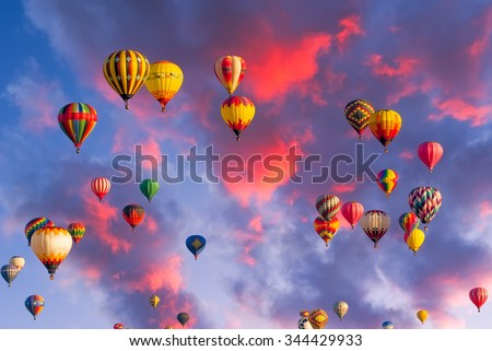 Colorful hot air balloons in flight  illuminated by early morning light