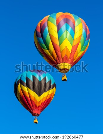 Colorful Hot Air Balloons Against Blue Stock Photo