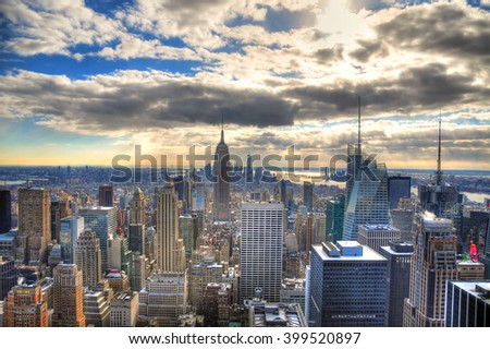 Colorful image of the skyline of Midtown Manhattan with its famous skyscrapers in HDR (high dynamic range) with blue sky in the day, New York City