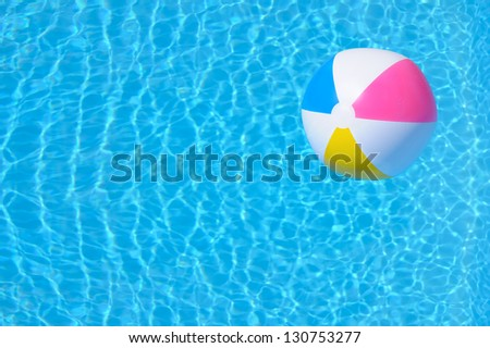 Colorful inflatable ball floating in swimming pool