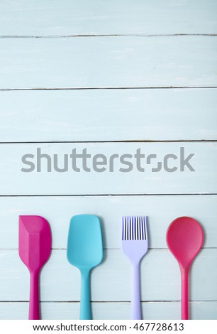 Kitchen Utensils Border colorful silicone baking utensils on pink stock photo 446216080