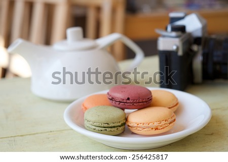 colorful macarons on withe plate Vintage style