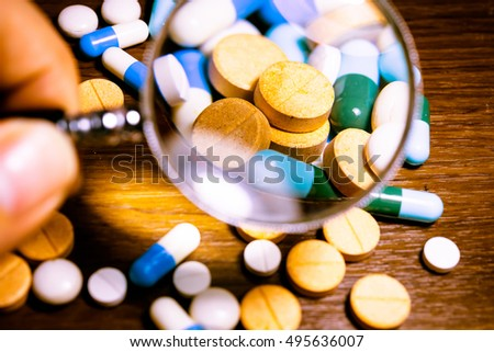Colorful medication and pills. Close-up of pile of yellow green tablets - capsule. Pills. Tablets. Capsule. Heap of pills. Pills and tablets as Medical background. Pill bottle spilling pills.