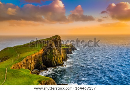 Colorful ocean coast sunset at Neist point lighthouse, Scotland, United Kingdom