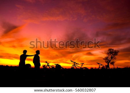 colorful of family cyclist and Bicycle silhouettes on the dark background of sunsets