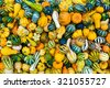 Colorful ornamental pumpkins and gourds as background, top view - stock photo