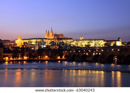 Colorful Prague gothic Castle with Charles Bridge after Sunset