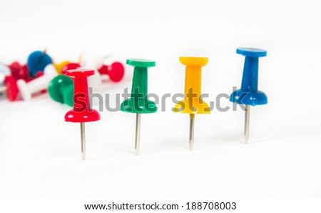 colorful push pins over white