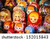 Colorful Russian nesting dolls matreshka at the market. Matrioshka Nesting dolls are the most popular souvenirs from Russia. - stock photo