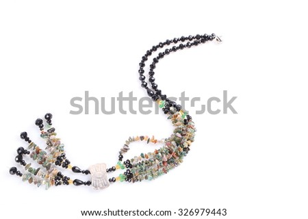 colorful semiprecious stone necklaces on white background