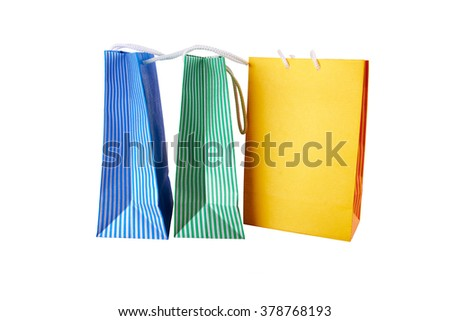 Colorful shopping bags with stripes in paper isolated on white