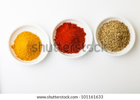 Colorful spices in white pods isolated on white