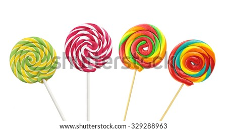Colorful spiral lollipops on white background