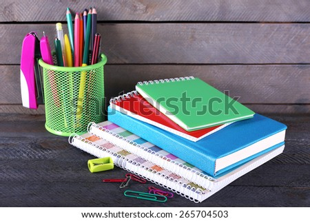 Colorful stationery on wooden background