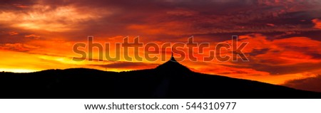 Colorful sunset sky panorama with silhouette of Jested Mountain Ridge, Liberec, Czech Republic, Europe