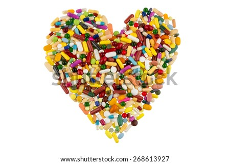 colorful tablets arranged in heart shape symbol photo for heart disease, medication and pharmaceuticals