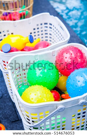 Colorful toys swimming pool for baby and kid in basket