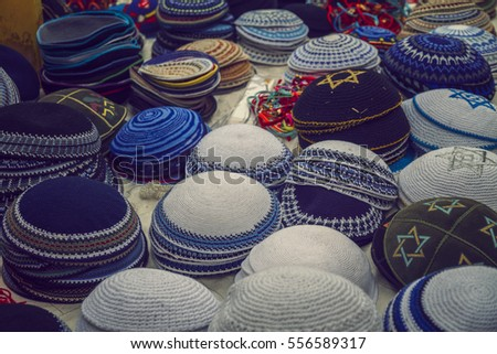 Colorful traditional jewish yarmulke piles for sale at the old city of Jerusalem, Israel