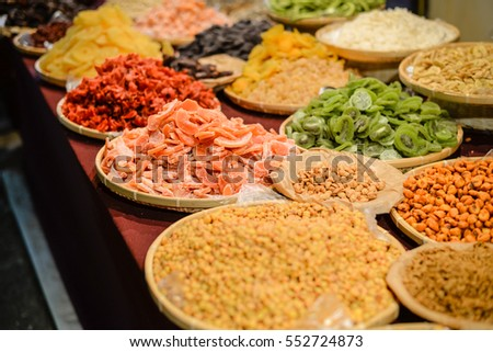 Colorful variety dry fruits and nuts in the street shop vibrant background