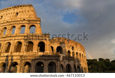 Colosseum in Rome by day with rainbow.
