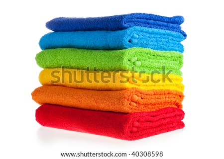 Colour terry towels combined by pile on white background. Isolated.