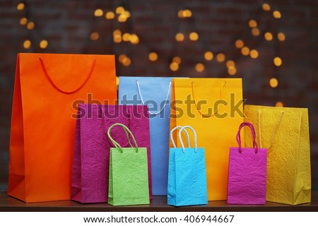 Coloured shopping bags on Christmas background