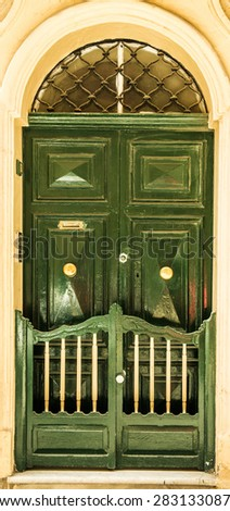 colourful green front door to house