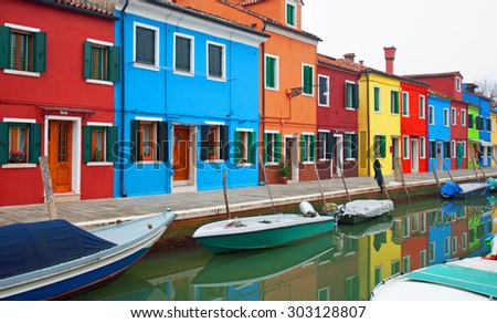 Colourful houses, adjacent to a canal, on the island of Burano, Italy
