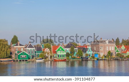 Colourful houses with dutch windmill in Zaaneschans, Netherland