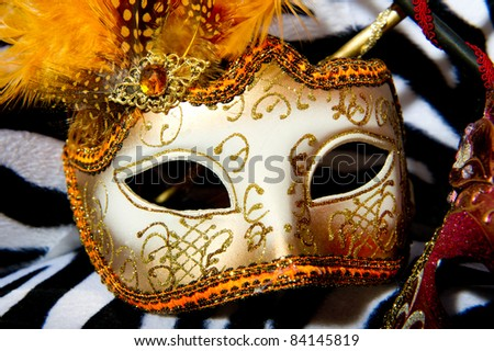 Colourful masquerade masks on retro chair
