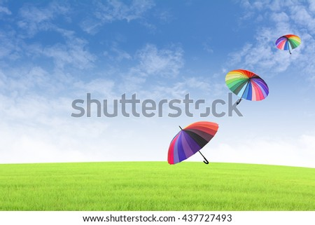 Colourful umbrellas floating in the sky