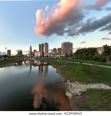 COLUMBUS, OHIO- JULY 16, 2016: Scioto River and Columbus Ohio skyline at John W. Galbreath Bicentennial Park at dusk in a panoramic