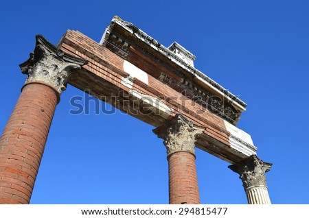 Columns And Entablature Fragment Of An Ancient Temple In Pompeii Against The Sky