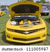 COMBINED LOCKS, WI - AUGUST 18: Yellow 2010 Chevy Camaro classic car at the 2nd Annual Horizon of Hope Generations Car and Truck Show on August 18, 2012 in Combined Locks, Wisconsin. - stock photo