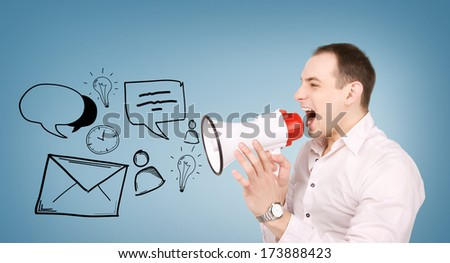 communication concept - businessman with megaphone over blue background