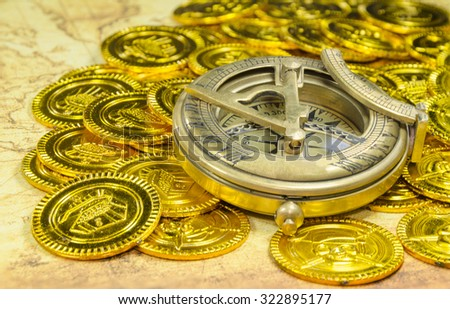 compass on a pirate golden coins