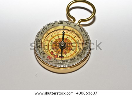 Compass on a white background. Photo of magnetic compass on white paper.