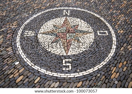 Compass on cobble stone