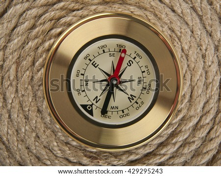 compass on the background of the rope closeup